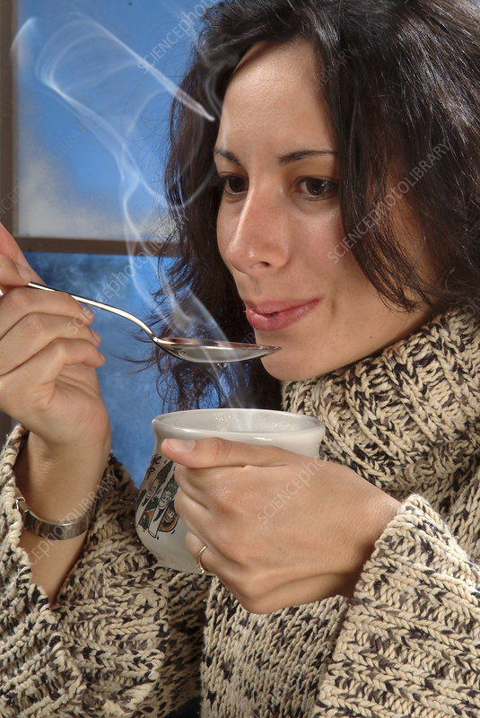 Science photo library caption model released eating soup woman in a