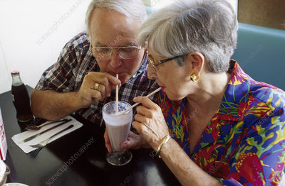 Senior couple shares soda