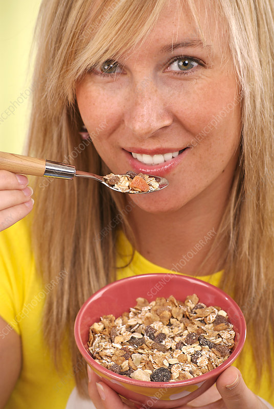 Woman eating muesli