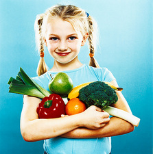 Girl holding fruit and vegetables