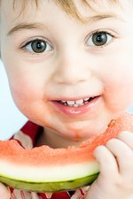 Toddler eating watermelon