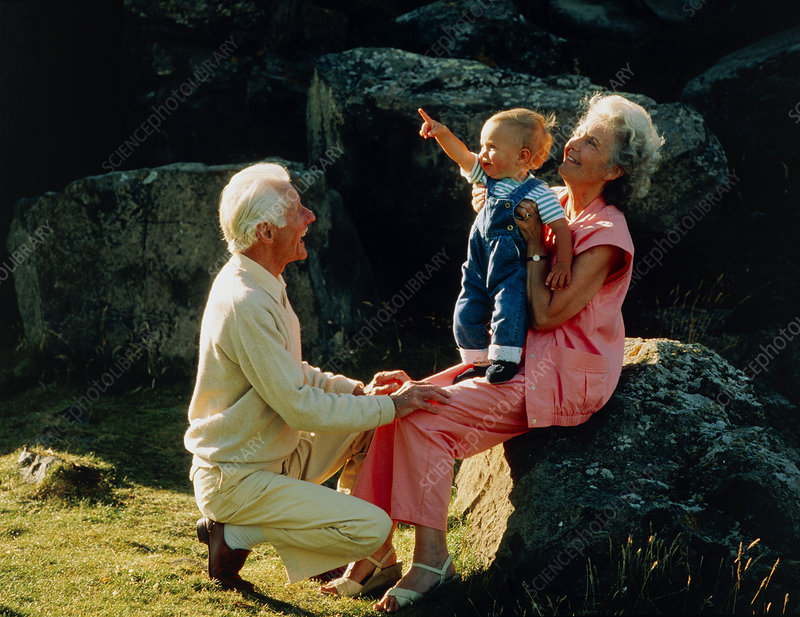 Elderly couple with grandchild in the countryside