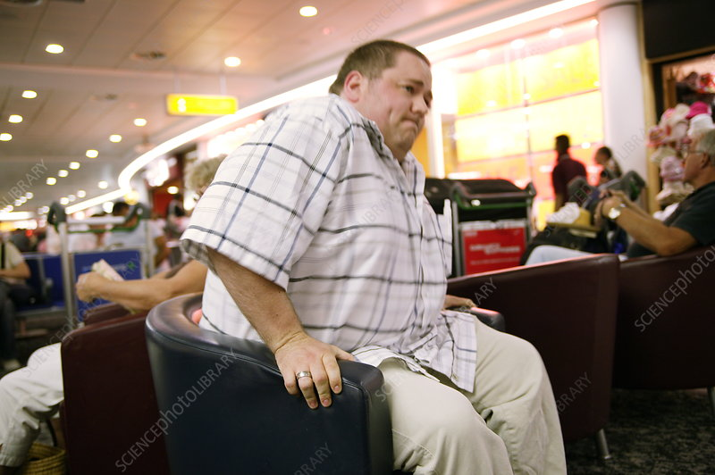 Obese man sitting down