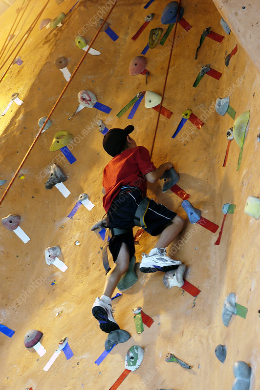 Boy exercising on climbing wall