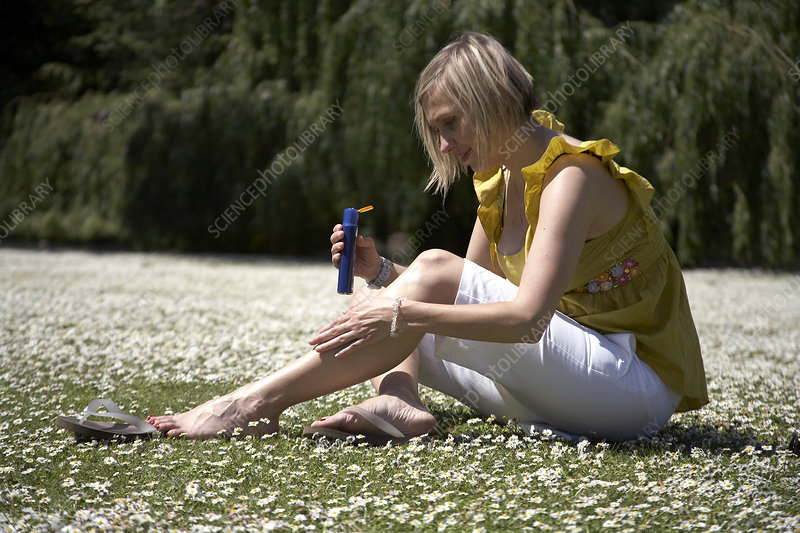 Woman applying suncream