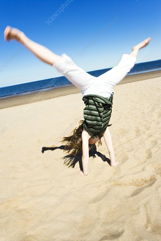 Girl doing a cartwheel