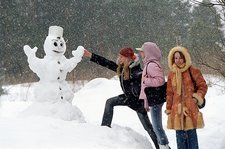 Teenage girls with a snowman