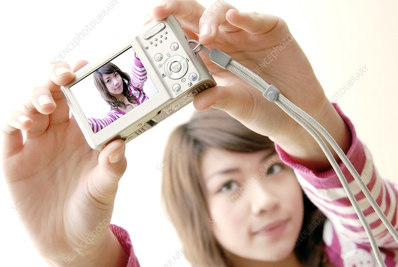 Woman taking a photograph of herself