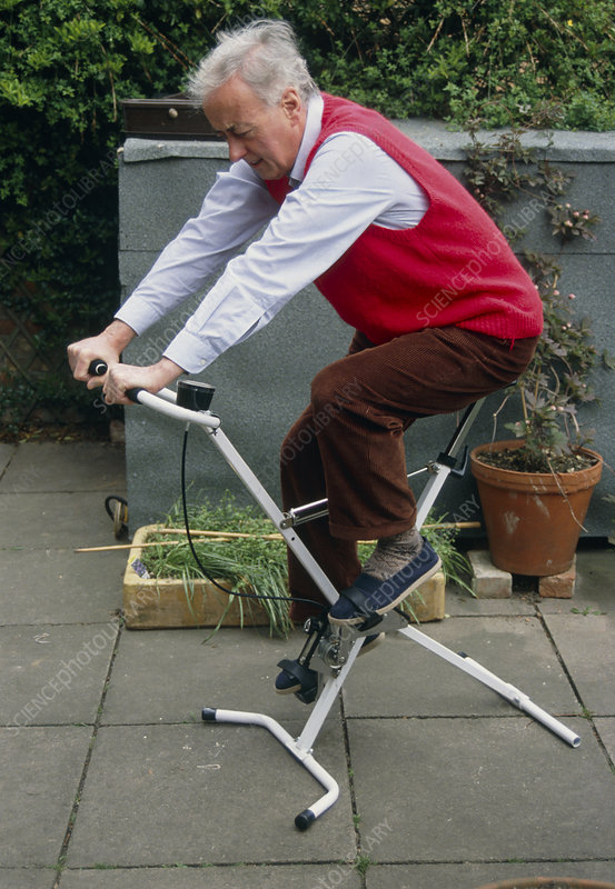 A man using an exercise bicycle.