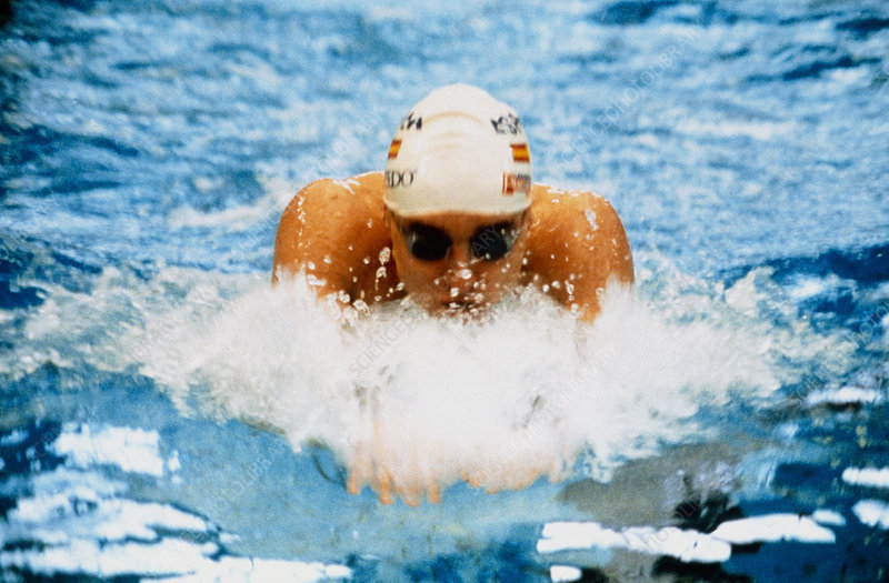 Male swimmer in swimming goggles and a cap