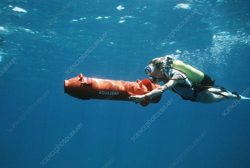 Scuba diver using a DPV