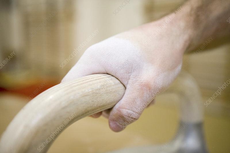 Gymnast gripping a handlebar