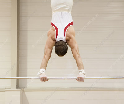 Gymnast performing a handstand