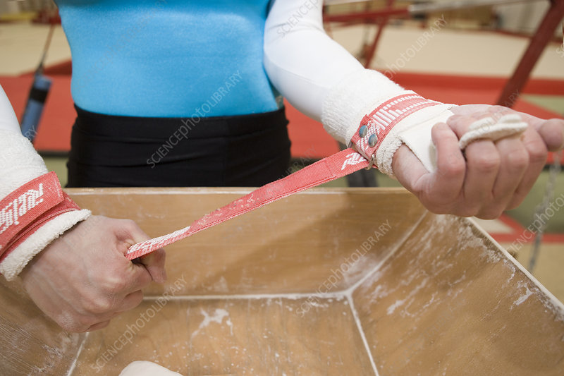 Gymnast putting on handguards