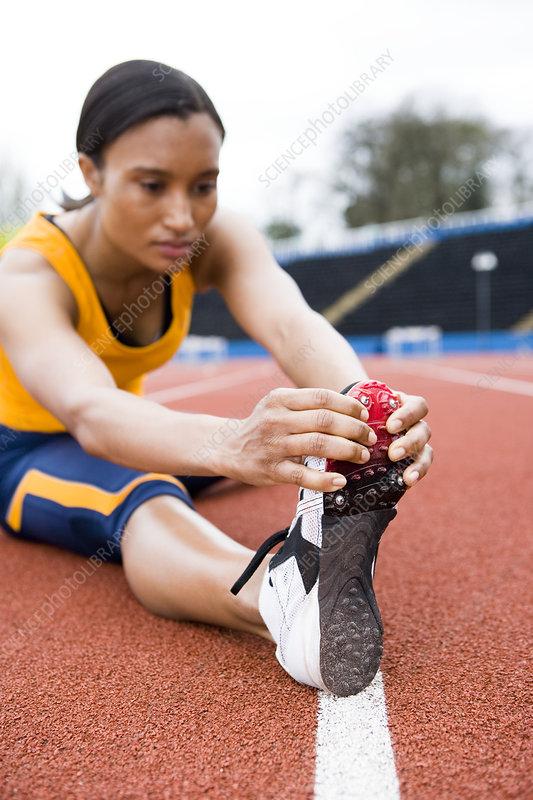 Athlete Doing Stretching Exercise Stock Photo - Image of