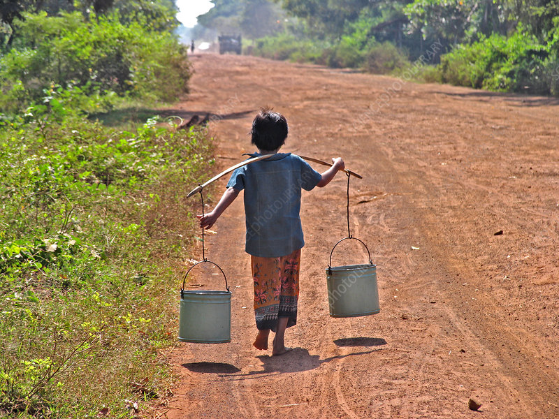 Boy carrying drinking water