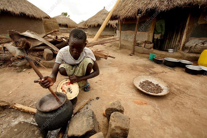 Cooking a meal, Uganda