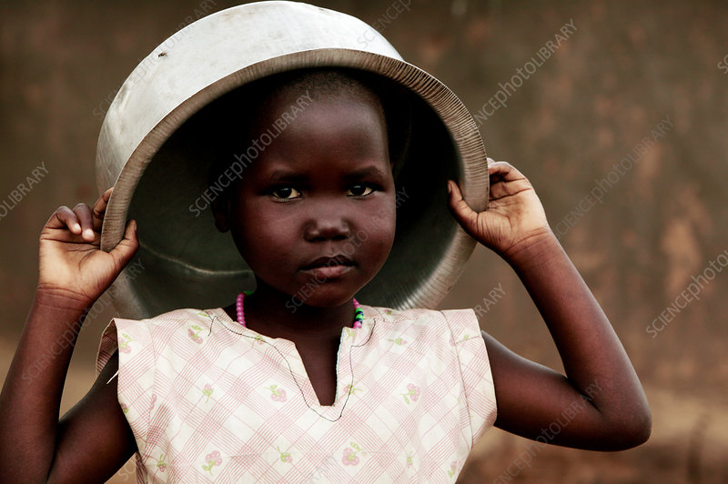 Child with a water bowl, Uganda