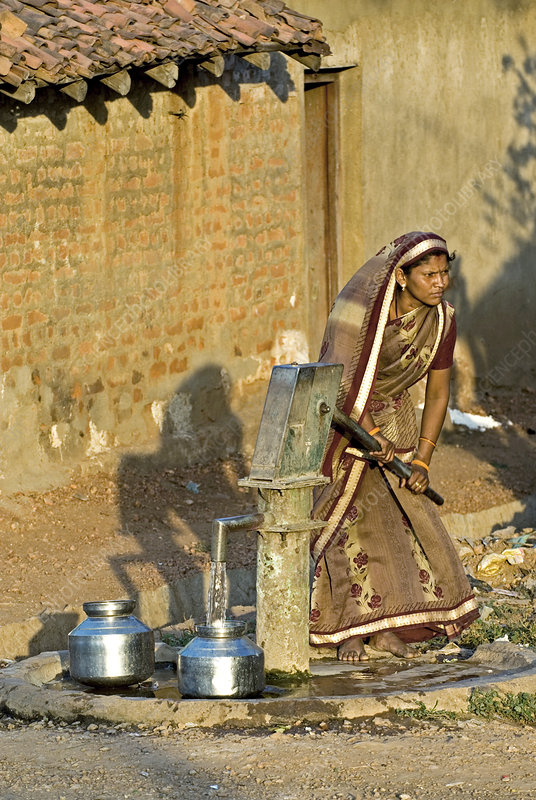 Woman operating water pump