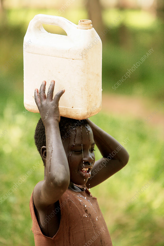 Ugandan child carrying water