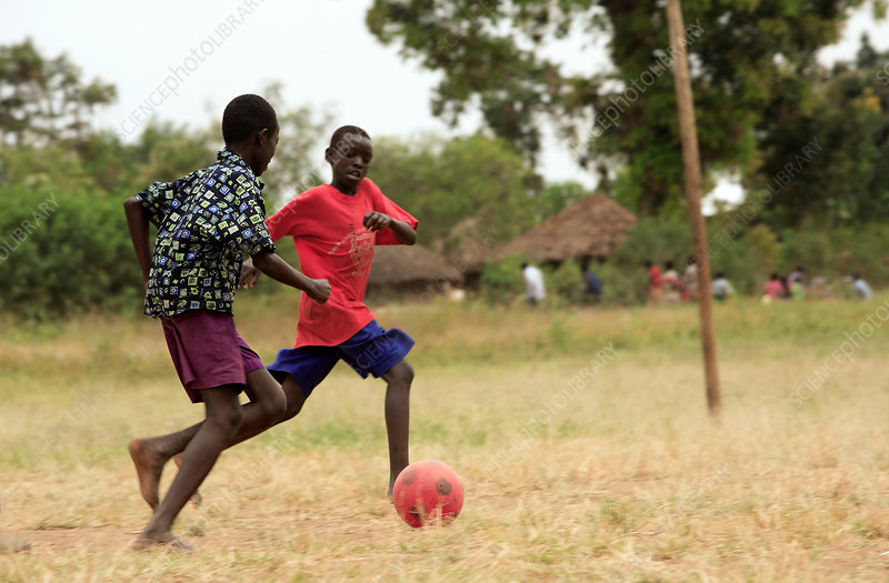 Boys playing football, Uganda