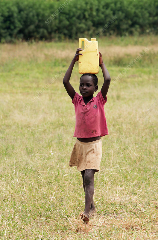 Ugandan boy carrying water