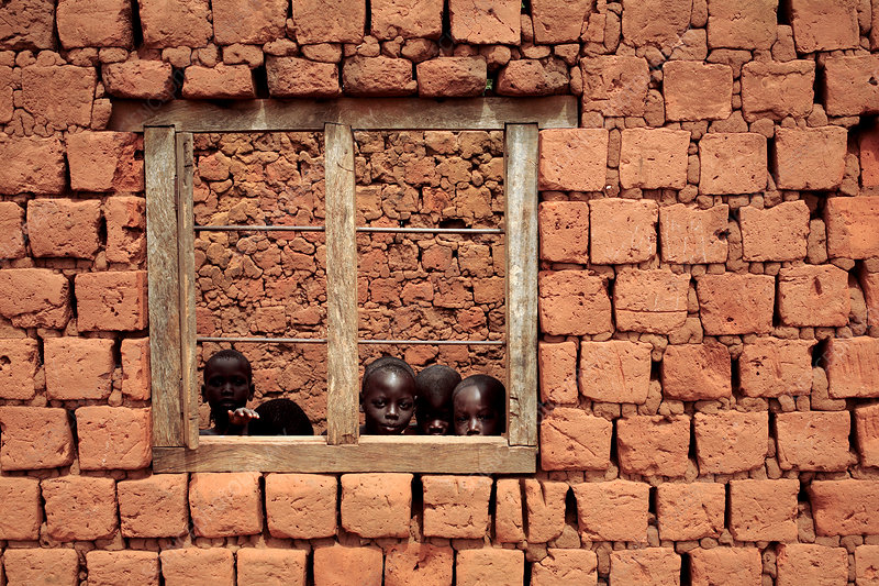 Children looking from a window, Uganda