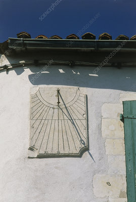 Sundial on the wall of a building