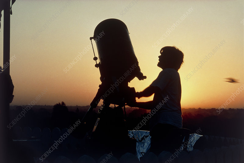 Astronomer at a solar eclipse observation site