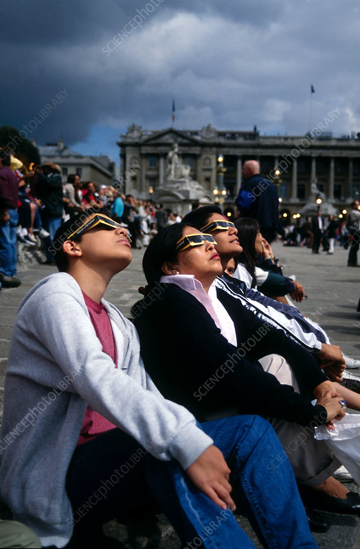 Watching a solar eclipse, Paris, France