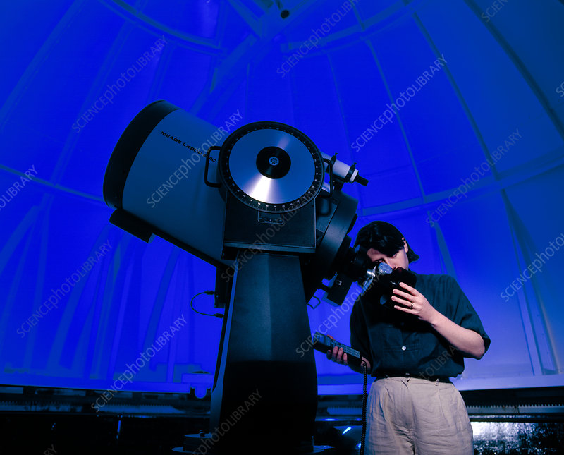 Astronomer operating an observatory telescope