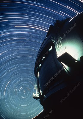 The dome of the Keck Telescope and star trails