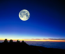 Observatories at Mauna Kea, Hawaii, with full moon