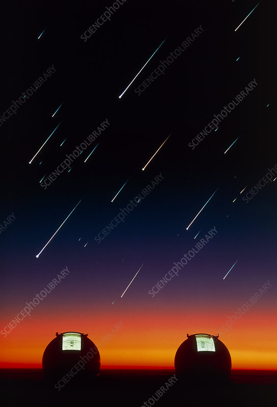 Telescope domes on Mauna Kea with meteors