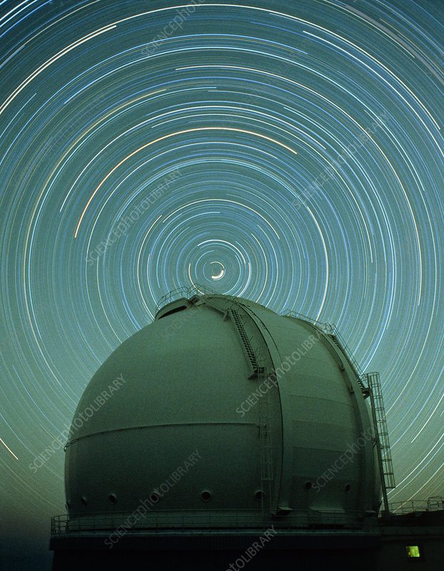 Time exposure of star trails over dome