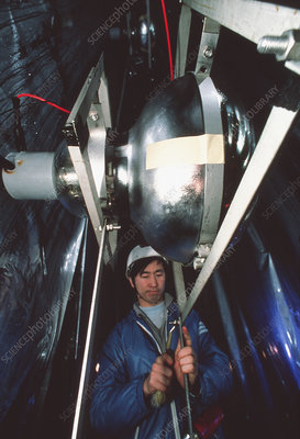 Technician working on Kamiokande neutrino detector