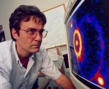 Scientist with image from Hubble Space Telescope