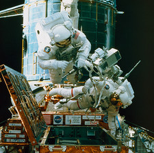Astronauts spacewalk to repair Hubble telescope