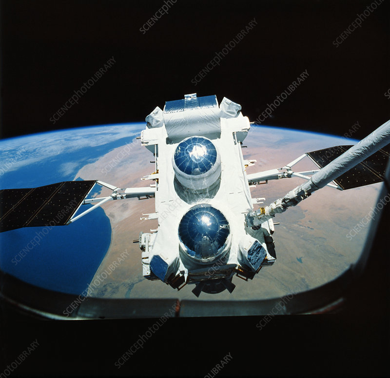Compton Observatory satellite with Shuttle arm