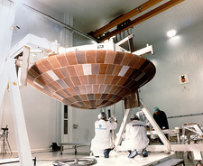 Technicians with the Huygens probe's heat shield