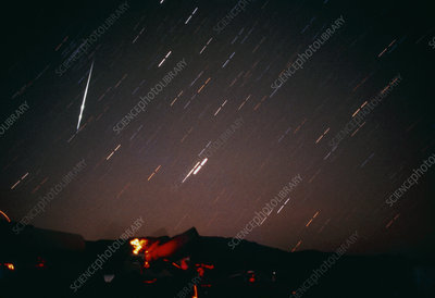 Photo of night sky showing a Geminid meteor