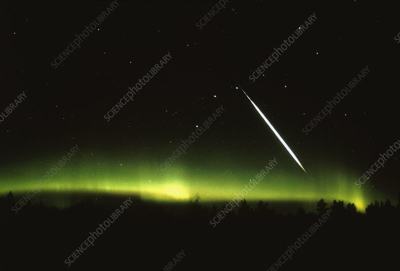 Bright fireball meteor and aurora borealis