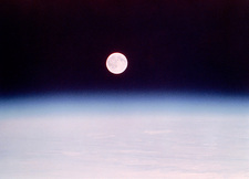 Skylab photo of full moon rising above airglow