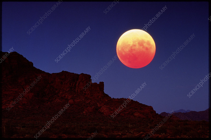 Total eclipse of the Moon over mountains