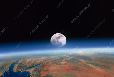 Moon rising over Earth