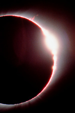 Total solar eclipse, showing a solar flare