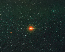 Starfield with the red supergiant Antares