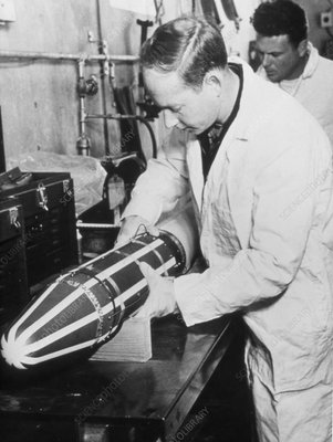 Technicians check the Explorer 1 satellite
