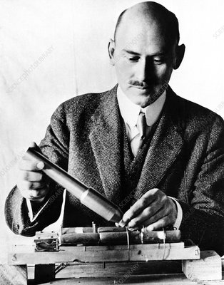 Dr Robert Goddard photographed with rocket