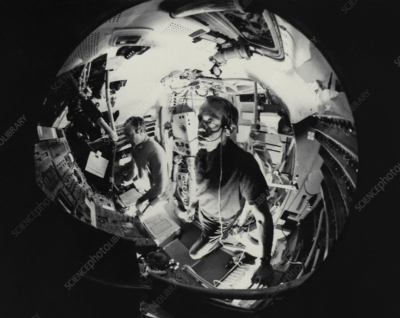 Fish-eyes lens view of 2 astronauts